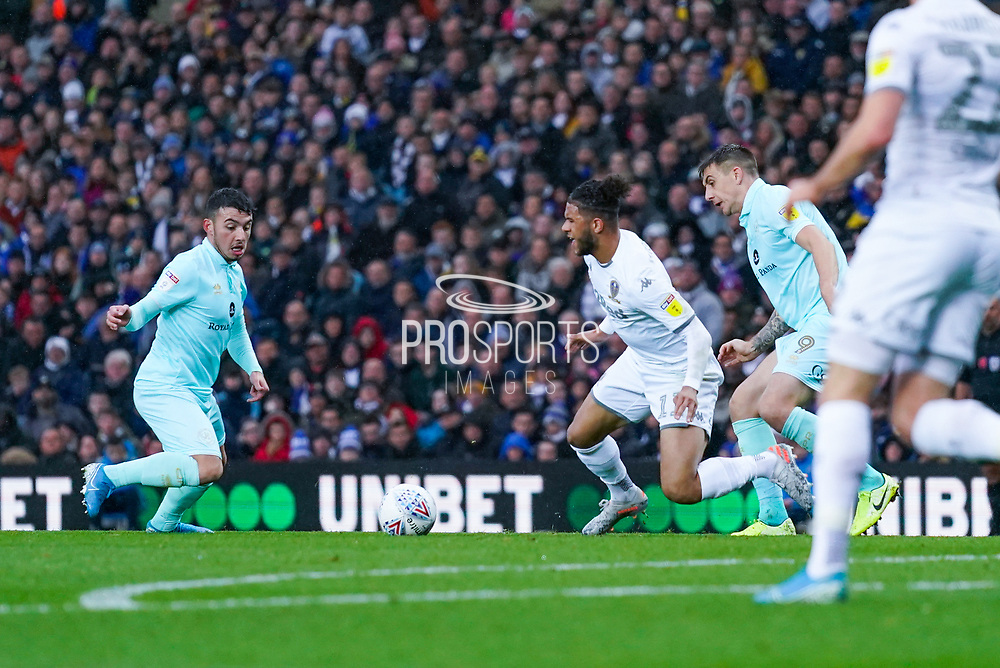 Leeds United forward Tyler Roberts (11) is fouled during the EFL Sky Bet Championship match between Leeds United and Queens Park Rangers at Elland Road, Leeds, England on 2 November 2019.