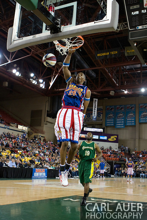 April 30th, 2010 - Anchorage, Alaska:  Hi-Lite Bruton of the World Famous Harlem Globetrotters plays to the crowd with a high flying slam dunk Friday night.
