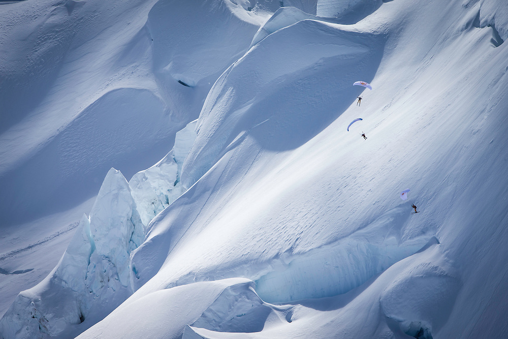 Jon Devore, Filippo Fabbi and Andy Farington fly through the middle of a glacier field while filming for the Unrideables in the Tordrillo Mountains near Anchorage, Alaska on April 24th, 2014.