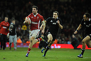 Alex Cuthbert of Wales breaks away to score his try. Dove Men autumn international series, Wales v New Zealand at the Millennium stadium in Cardiff , South Wales on Saturday 24th November 2012. pic by Andrew Orchard, Andrew Orchard sports photography,