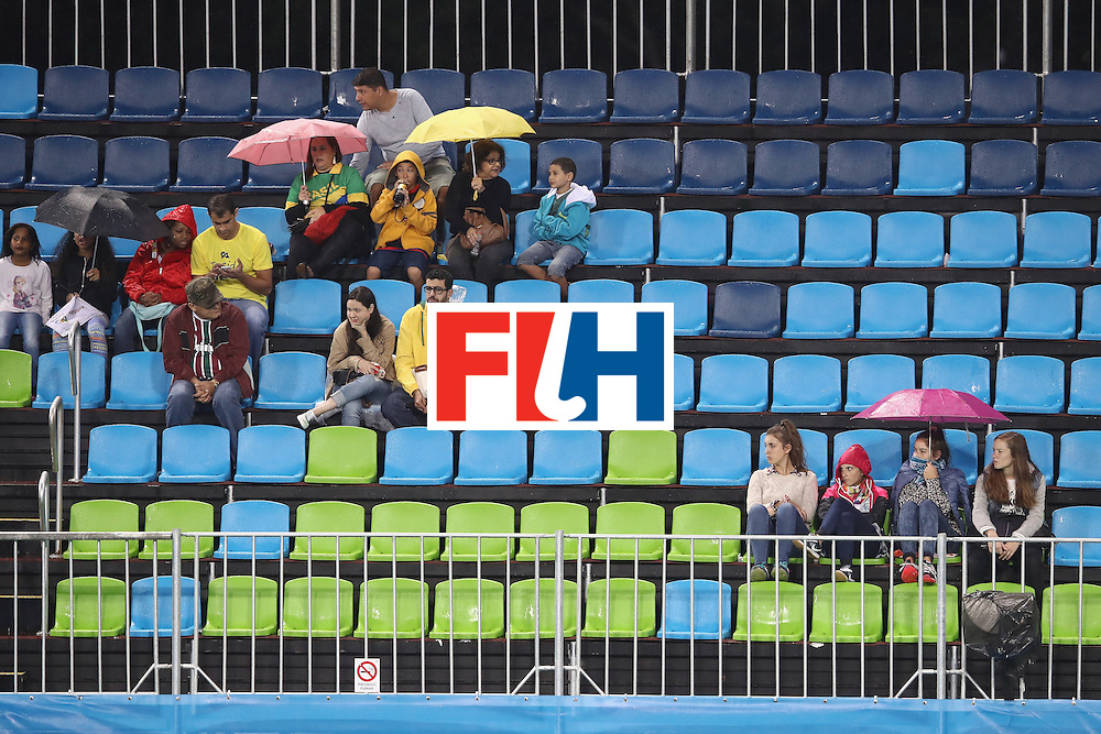 RIO DE JANEIRO, BRAZIL - AUGUST 10:  The crowd watch on as rain falls during the women's pool B match between the United States and Japan on Day 5 of the Rio 2016 Olympic Games at the Olympic Hockey Centre on August 10, 2016 in Rio de Janeiro, Brazil.  (Photo by Mark Kolbe/Getty Images)