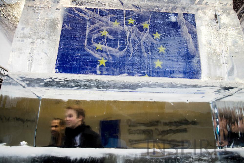 "BRUSSELS - BELGIUM - 10 FEBRUARY 2009 --  The EU-flag inside an ""Ice Cube"" illustrating a ""Climate Change"" simulation model outside the Commission on Berlaymont Esplanade.  Photo: Erik Luntang/INSPIRIT Photo"