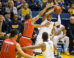 West Virginia Mountaineers guard Jevon Carter (2) looks to pass the ball against the Texas Tech Red Raiders during the second half at the WVU Coliseum.