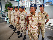 25 OCTOBER 2016 - MAE SOT, TAK, THAILAND:  Thai defense volunteers in the customs post in Mae Sot. The Thai-Myanmar border between Mae Sot and Myawaddy has become an important commercial crossing as democratic reforms in Myanmar (Burma) has created new economic opportunities in Thailand.   PHOTO BY JACK KURTZ