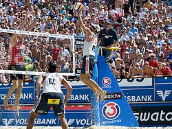 Marcio Araujo of Brazil strikes over Matt Fuerbringer's block at A1 Beach Volleyball Grand Slam tournament of Swatch FIVB World Tour 2010, semifinal, on August 1, 2010 in Klagenfurt, Austria. (Photo by Matic Klansek Velej / Sportida)
