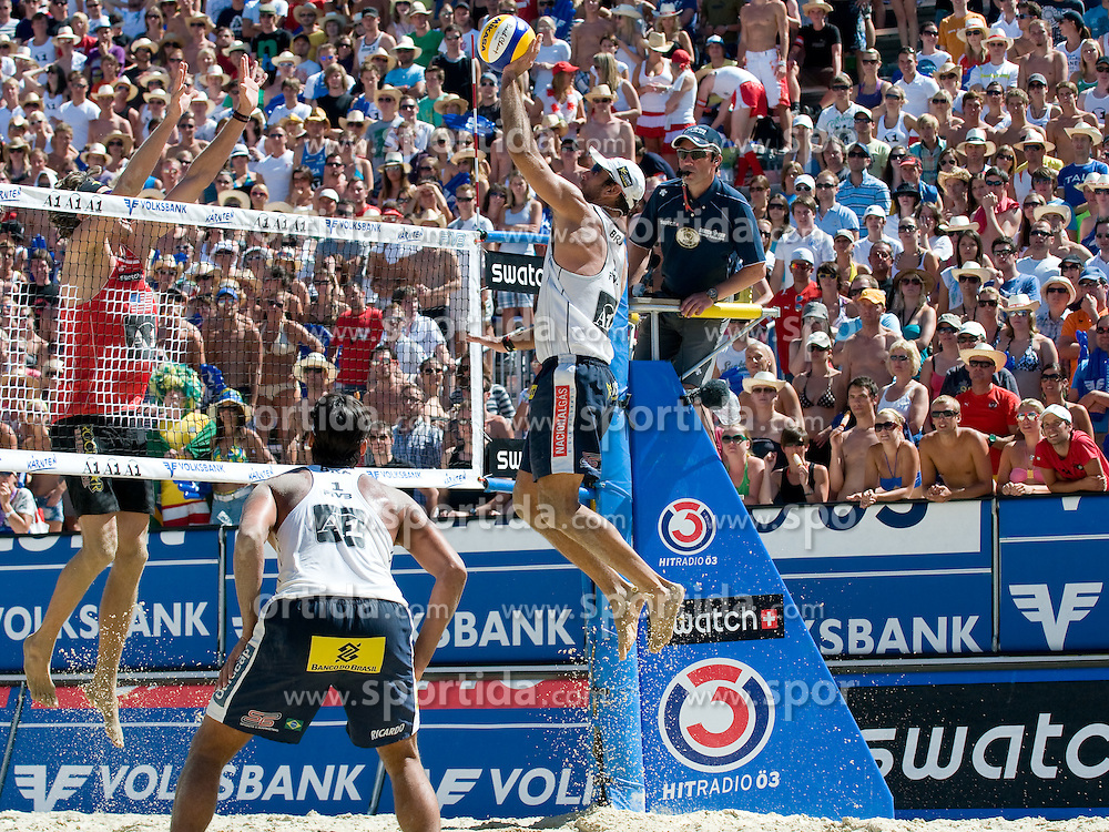 Marcio Araujo of Brazil strikes over Matt Fuerbringer's block at A1 Beach Volleyball Grand Slam tournament of Swatch FIVB World Tour 2010, semifinal, on August 1, 2010 in Klagenfurt, Austria. (Photo by Matic Klansek Velej / Sportida)