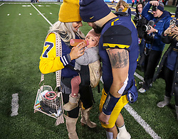 Oct 25, 2018; Morgantown, WV, USA; West Virginia Mountaineers quarterback Will Grier (7) celebrates with his wife and daughter after beating the Baylor Bears at Mountaineer Field at Milan Puskar Stadium. Mandatory Credit: Ben Queen-USA TODAY Sports