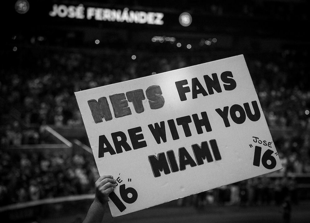 A Mets' fan holds a sign showing support for Miami's supporters during Monday's game against New York.