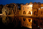 Night view of norias in Hama, Syria. Norias are characteristic of Hama. They have been used since centuries to collect water from the river and use it for agricultural purposes.