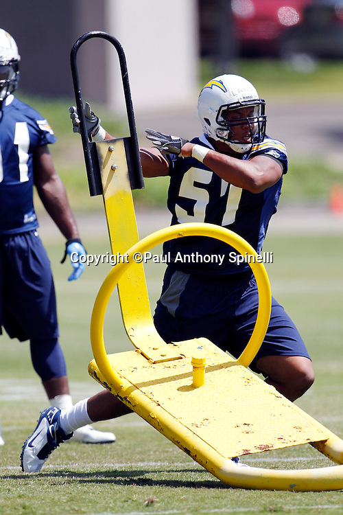 San Diego Chargers rookie linebacker Brandon Lang (57) works out on a blocking sled during a Chargers rookie minicamp on May 7, 2010 in San Diego, California. (©Paul Anthony Spinelli)