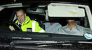 15.JUNE.2009 - LONDON<br /> <br /> GUY RITCHIE WHO LEFT HIS PUB THE PUNCHBOWL IN MAYFAIR AT 2.00AM IN HIS CAR DRIVEN BY HIS DRIVER GETS PULLED OVER BY THE POLICE ON DAVIES STREET, MAYFAIR WHERE HIS DRIVER GOTSTOPPED BY THE POLICE AND BOTH GUY AND THE DRIVER HAD NO SEATBELTS ON, GUY HAD CALM SACHETS IN THE CAR WHICH HE STARTED REACHING FOR THE POLICE THEN DROVE GUY'S CAR WITH GUY SITTING IN THE BACK SEAT AND THE DRIVER IN THE FRONT SEAT TRYING TO COVER UP HIS FACE AS THEY WERE BEING DRIVEN OFF BY THE POLICE.<br /> <br /> BYLINE: EDBIMAGEARCHIVE.COM<br /> <br /> *THIS IMAGE IS STRICTLY FOR UK NEWSPAPERS AND MAGAZINES ONLY* <br /> *FOR WORLD WIDE SALES AND WEB USE PLEASE CONTACT EDBIMAGEARCHIVE - 0208 954 5968*