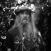 Shea, The Messiah. Wexford.<br /> <br /> &ldquo;I don&rsquo;t know if there are men on the moon but if there are they must be using the earth as their lunatic asylum&rdquo;<br /> <br /> George Bernard Shaw<br /> <br /> Some people live only one life but &lsquo;the messiah&rsquo; has lived many. In an industrial school as a boy, he heard and saw things that he dare not tell a soul. Heroin addiction. Professional football player. Fighter in the Yemen and Somalia with the RAF. A musician, the best in the world. A drummer so good Tina Turner&rsquo;s band wanted him. A songwriter with a no. 1 hit that the church tried to ban. A wanderer that has lived in the same place for sixteen years. A single father. An intellectual. A dreamer..<br /> <br /> And a dog lover.  Mulligan, the chicken killer, bucking in the back yard when the word &lsquo;river&rsquo; is mentioned in three languages. Sandy haired Mulligan, the trilingual lurcher, pining for water to jump into on a hot July afternoon, envious of cool teenagers jumping off the Slaney bridge in turns.<br /> <br /> &lsquo;The messiah&rsquo; from Dalkey came to Wexford to be with his clan. The Doyles.<br /> <br /> In his purple and gold shorts and his crown without thorns..