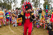 The La Capitaine whips revelers into line during the Faquetigue Courir de Mardi Gras chicken run on Fat Tuesday February 17, 2015 in Eunice, Louisiana. The traditional Cajun Mardi Gras involves costumed revelers competing to catch a live chicken as they move from house to house throughout the rural community.