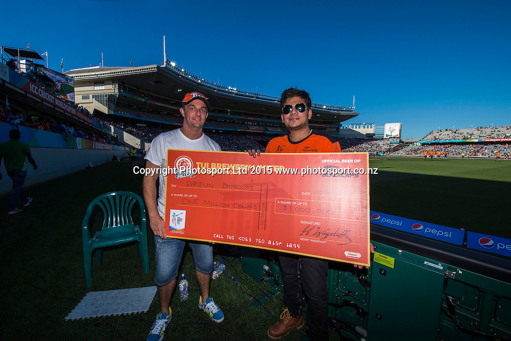 Tui catch-a-million winner Arjun Bharadwaj during the ICC Cricket World Cup match between India and Zimbabwe at Eden Park in Auckland, New Zealand. Saturday 14 March 2015. Copyright Photo: Raghavan Venugopal / www.photosport.co.nz