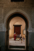 Bouinania Medersa is a 14th-century religious college. The best example of Islamic architecture a non-Muslim can see in Fez, with wooden walls elaborately carved with geometric patterns and Arabic calligraphy, and a beautiful minaret. In the courtyard there is a portico with a still-functioning mosque, separated by the rest of the courtyard by a small moat.