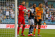 Millwall goalkeeper Bartosz Bialkowski (33), Millwall defender Mahlon Romeo (12) and Hull City forward Josh Magennis (27) during the EFL Sky Bet Championship match between Millwall and Hull City at The Den, London, England on 31 August 2019.