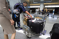 SAN FRANCISCO, CA - JULY 3 :  Sgt. Cliff Java of the San Francisco police department and his dog Jacky check the luggage in the ticketing area of the International Terminal at the San Francisco International Airport on July 3, 2007 in San Francisco, California. Security threat level was raised to orange as the nation gets ready for the Fourth of July holiday.  (Photograph by David Paul Morris)