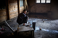 A migrants is seen performing ablutions in one of the abandoned wearhouse where about 900 migrants now lives. March 17th, 2017, Belgrade, Serbia. Federico Scoppa/CAPTA