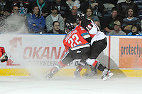 KELOWNA, CANADA, OCTOBER 26:   Mackenzie Johnston #22 of the Kelowna Rockets is check by Spencer Asuchak #16 of the Prince George Cougars as the Prince George Cougars visit the Kelowna Rockets on October 26, 2011 at Prospera Place in Kelowna, British Columbia, Canada (Photo by Marissa Baecker/Shoot the Breeze) *** Local Caption ***Mackenzie Johnson;