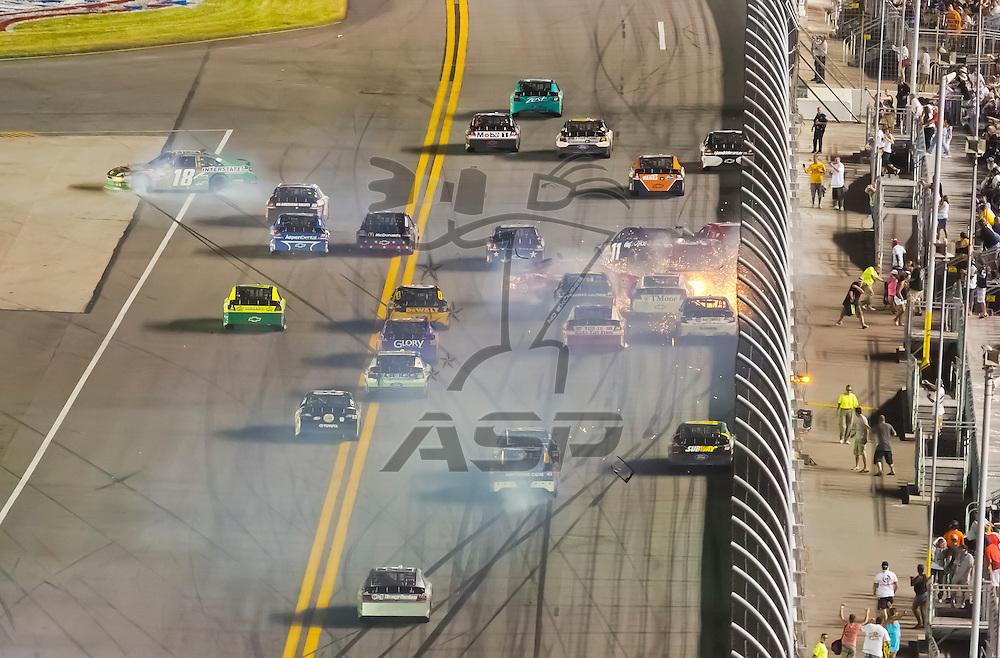 DAYTONA BEACH, FL - JUL 07, 2012:  The field crashed through the fronstretch during the Coke Zero 400 at the Daytona International Speedway in Daytona Beach, FL.