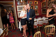 GWYNETH PALTROW; MARIO TESTINO; Dinner hosted by Elizabeth Saltzman for Mario Testino and Kate Moss. Mark's Club. London. 5 June 2010. -DO NOT ARCHIVE-© Copyright Photograph by Dafydd Jones. 248 Clapham Rd. London SW9 0PZ. Tel 0207 820 0771. www.dafjones.com.