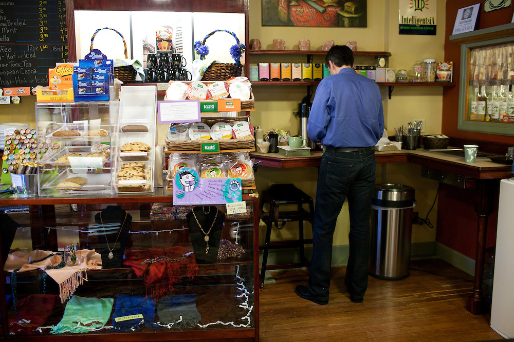 Republican presidential hopeful Tim Pawlenty buys a cup of coffee at a shop on Tuesday, July 26, 2011 in Washington, IA.