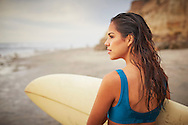 A woman surveys the shore break on the Pacific Coast of Southern California.