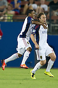 FRISCO, TX - JULY 13:  Ned Grabavoy #20 of Real Salt Lake is tackled by teammate Jou Plata #8 after scoring a goal against FC Dallas on July 13, 2013 at FC Dallas Stadium in Frisco, Texas.  (Photo by Cooper Neill/Getty Images) *** Local Caption *** Ned Grabavoy