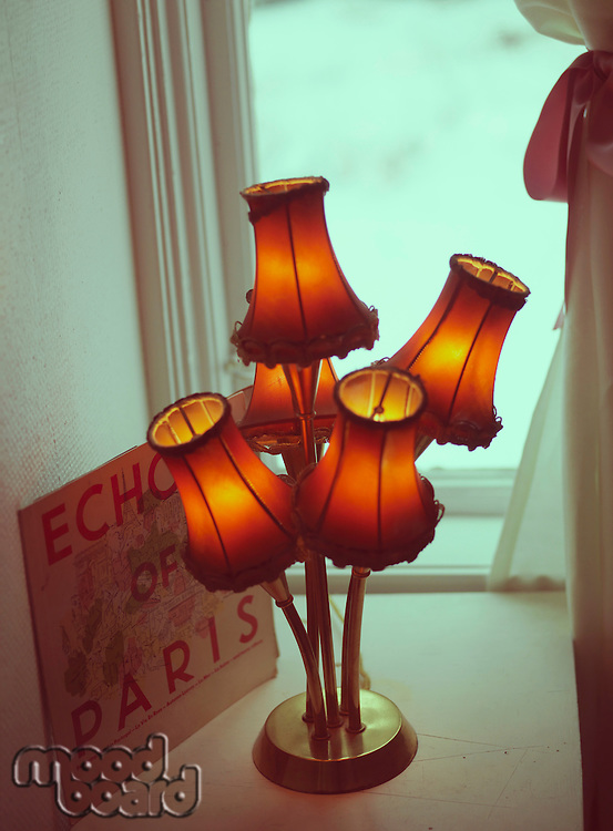 "Old fashioned lamp and ""Echo of Paris' advert"
