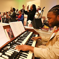 Adam Robison | BUY AT PHOTOS.DJOURNAL.COM<br /> Rodney Nash, a church member at Inspirational Community Baptist Church, plays the organ as the choir leads the worship service at First Pentecostal Church in Tupelo on Tuesday night. The two churches gather twice a year for their Racial Reconciliation service.