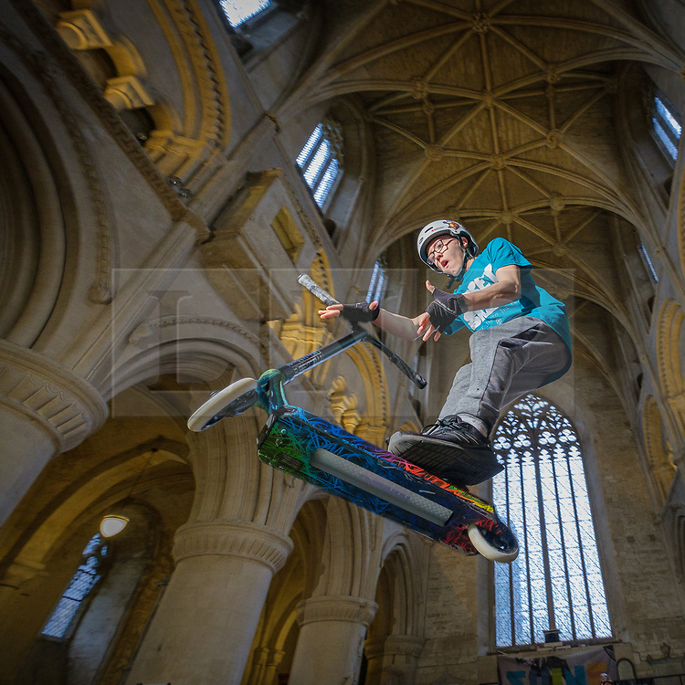 © Licensed to London News Pictures 19/02/2020, Malmesbury, UK.  Josh Scott, 13, gets some air on his scooter at the Malmesbury Skate Festival. The annual event sees the inside of Malmesbury's 12th Century former Benedictine Abbey being turned into a skate park for the week during school half term. Photo Credit : Stephen Shepherd/LNP
