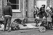 A group of young people sitting on the Lambeth pavements, 'Scumoween', Whitgift Street, Lambeth, London, UK, 31 October, 2015