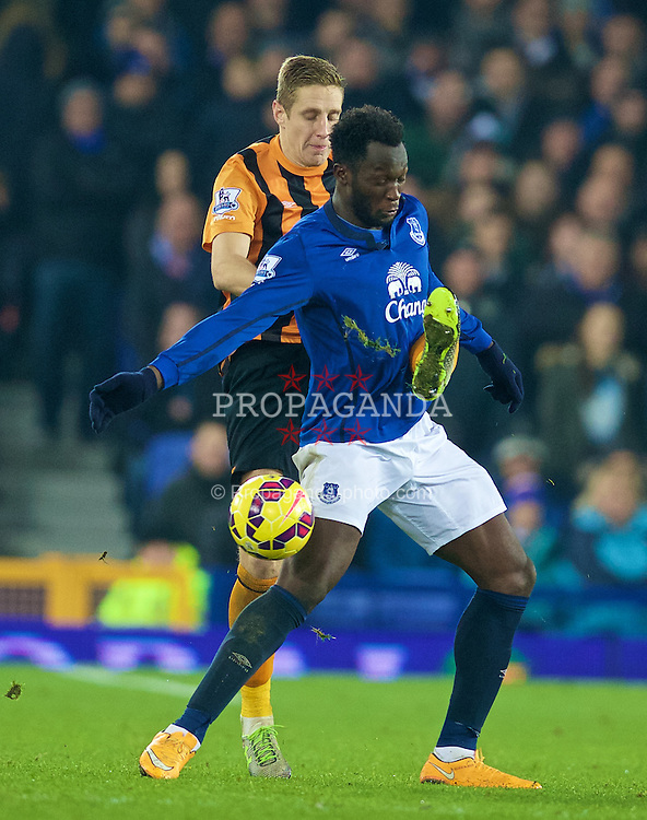 LIVERPOOL, ENGLAND - Wednesday, December 3, 2014: Everton's Romelu Lukaku in action against Hull City's Michael Dawson during the Premier League match at Goodison Park. (Pic by David Rawcliffe/Propaganda)