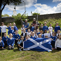 Pupils of St Ninians PS in Stirlingenjoy the event with two gentlemen from Clanranald Trust dressed as Wiliam Wallace and Andrew de Moray.<br /> <br /> BRAVEHEART HEROES, WILLIAM WALLACE AND ANDREW DE MORAY, FINALLY HONOURED AT STIRLING BRIDGE BATTLE SITE AS SALTIRE RAISED FOR FIRST TIME IN OVER 700 YEARS<br /> <br /> Friday 29th May, 2015<br /> <br /> IT&rsquo;S TAKEN more than 700 years but today, the two heroes at the centre of one of the most important battles in Scottish history have been jointly honoured at the spot where they both led an outnumbered Scottish army to victory against the English.<br /> The formal unveiling ceremony at Stirling Bridge today (Friday 29th May), of three lecterns made of traditional Scottish whinstone dedicated to the memory of William Wallace and Andrew de Moray,&nbsp;at site of the historic victory at Battle of Stirling Bridge.<br /> At a special ceremony attended by Andrew de Moray&rsquo;s direct descendant, the Earl of Moray, and Stewart Maxwell, MSP, convener of the Scottish Parliament&rsquo;s Education and Culture Committee, the memorials were formally unveiled.Mr Maxwell opened the event and after the dedication, together with the Earl of Moray, they raised the Saltire together at the site of the Battle of Stirling Bridge. This is the first time in over 700 years that the Saltire has flown at Stirling Bridge. The flag will now become a permanent fixture at the site of the Battle.<br /> John Stuart, the current Earl of Moray, said of his illustrious kinsman: &ldquo;I am delighted that Andrew de Moray is finally, after 700 years, to have the recognition he deserves. The Guardians of Scotland have put a huge amount of time and effort into the lecterns, which are a very fitting tribute to one of Scotland's greatest patriots.&quot;<br /> The victory represented a key moment in the Scottish Wars of Independence. Eminent Scots historian, Sir Tom Devine, recently described the battle as being &lsquo;second in importance only to Bannockburn in the Wars of Independence&rsquo;.&nbsp;<br /> It is the first time the two men have been give