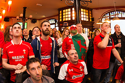 © London News Pictures. 12/03/2016 Aberystwyth, Wales, UK.  Welsh rugby fans in the Castle Hotel Aberystwyth, watch television coverage of Wales playing England in the Six Nations rugby international series. Photo credit: Keith Morris/LNP