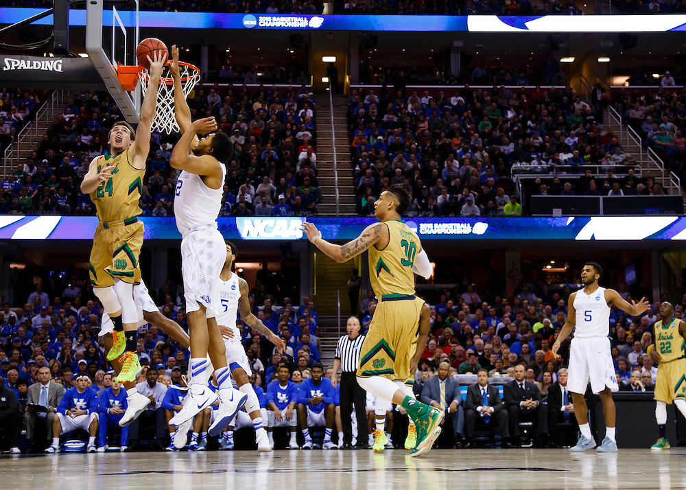 Mar 28, 2015; Cleveland, OH, USA; Notre Dame Fighting Irish guard/forward Pat Connaughton (24) goes to the basket defended by Kentucky Wildcats forward Karl-Anthony Towns (12) in the finals of the midwest regional of the 2015 NCAA Tournament at Quicken Loans Arena. Mandatory Credit: Rick Osentoski-USA TODAY Sports