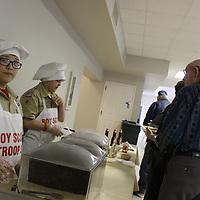 Thomas Oakes, left, prepares to serve sausage during Troop 39's pancake breakfast.