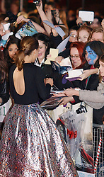 Israeli US actress Natalie Portman with her fans as she arrives for the World Premiere of her latest film Thor The Dark World.  in London's Leicester Square, England, United Kingdom. Tuesday, 22nd October 2013. Picture by Max Nash / i-Images