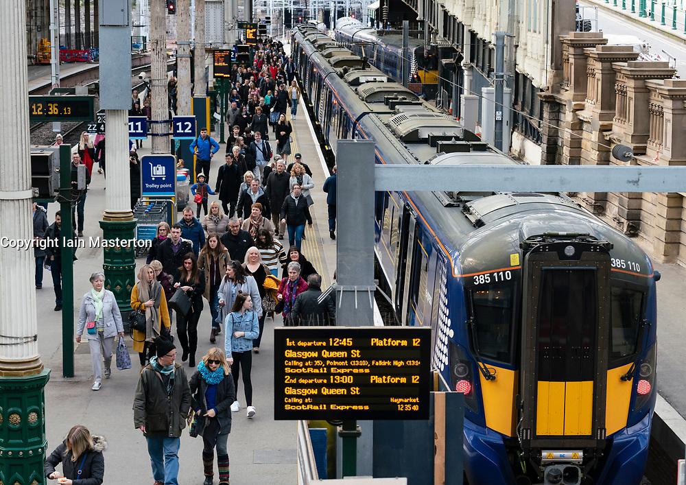 Passengers disembark onto platform from Scotrail train  at Waverley Station iN Edinburgh, Scotland, UK