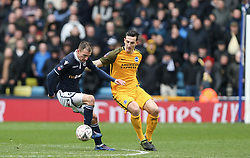 Jed Wallace of Millwall holds the ball up under pressure from Lewis Dunk of Brighton and Hove Albion- Mandatory by-line: Arron Gent/JMP - 17/03/2019 - FOOTBALL - The Den - London, England - Millwall v Brighton and Hove Albion - Emirates FA Cup Quarter Final