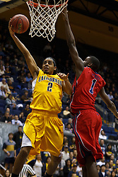 March 16, 2011; Berkeley, CA, USA;  California Golden Bears guard Jorge Gutierrez (2) shoots past Mississippi Rebels forward Terrance Henry (1) during the second half of the first round of the National Invitation Tournament at Haas Pavilion.  California defeated Mississippi 77-74.