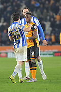 Hull City midfielder Moses Odubajo (2) confronts Fernando Forestieri of Sheffield Wednesday before Fernando Forestieri of Sheffield Wednesday was sent off  during the Sky Bet Championship match between Hull City and Sheffield Wednesday at the KC Stadium, Kingston upon Hull, England on 26 February 2016. Photo by Ian Lyall.