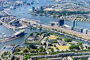 Nederland, Noord-Holland, Amsterdam, 29-06-2018; centrum van de stad, Oosterdok met Nemo Science Museum met ingang van IJtunnel. Rechts Marineterrein, voormalige Marine etablissement, Scheepvaartmuseum. Piet Heinkade met IJ-oever.<br /> City centre, Eastern Dock with new hotspot former Navy yard.<br /> <br /> luchtfoto (toeslag op standard tarieven);<br /> aerial photo (additional fee required);<br /> copyright foto/photo Siebe Swart