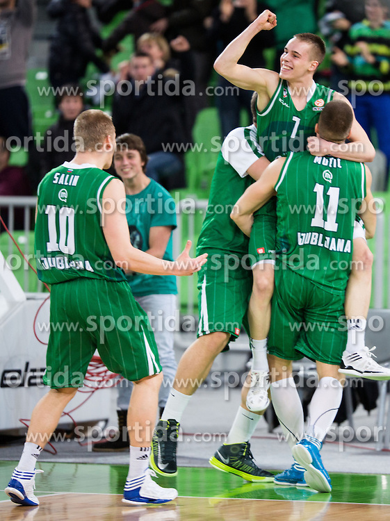 Players of Union Olimpija celebrate victory after game-winning three points by Klemen Prepelic  of Union Olimpija during basketball match between KK Union Olimpija and Khimki Moscow Region (RUS) in 9th Round of Regular season of Euroleague 2012/13 on December 7, 2012 in Arena Stozice, Ljubljana, Slovenia. Union Olimpija defeated Khimki Moscow Region 74:72. (Photo By Matic Klansek Velej / Sportida)