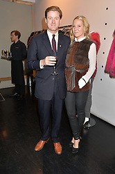 TOM NAYLOR-LEYLAND and ALICE NAYLOR-LEYLAND at a preview of the Hockley Autumn -Winter 2013/2014 Collection at Hockley, 20 Conduit Street, London on 26th November 2013.