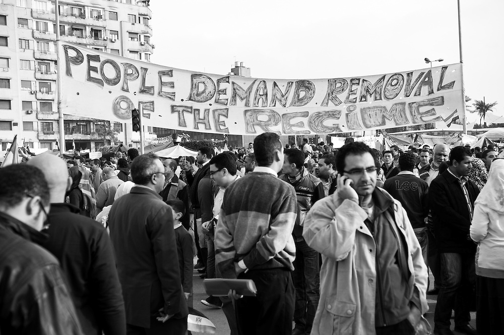 A sign in Tahrir Square spelling out the protest slogan so frequently heard in the many Arab countries rocked by protest in 2011: PEOPLE DEMAND REMOVAL OF THE REGIME. This photo was taken two days before the resignation of President Mubarak in Egypt. (Cairo, Egypt - February 9, 2011)