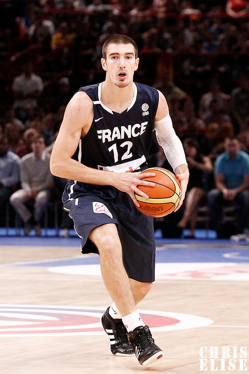 15 July 2012: Nando De Colo of Team France passes the ball during a pre-Olympic exhibition game won 75-70 by Spain over France, at the Palais Omnisports de Paris Bercy, in Paris, France.