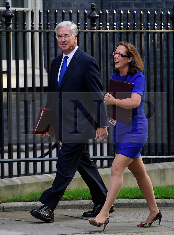 © Licensed to London News Pictures. 13/09/2016. London, UK.  Defence Secretary Michael Fallon (L) and  Leader of the House of Lords Baroness Natalie Evans arrive at 10 Downing Street in London for cabinet meeting on September 13, 2016. Photo credit: Ben Cawthra/LNP