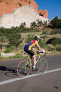 A road biker hits the cycling loop in Garden of the Gods, Colorado Springs, Colorado