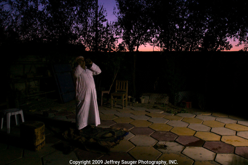 Saleh Dawoud, a Shiite Iraqi, prays before sunrise at his home in Nasiriyah, Iraq, on August 14, 2003.